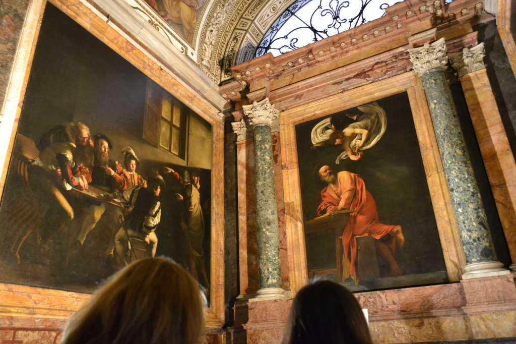 "Grabbing a quick (no flash) snapshot of two of the Caravaggios in San Luigi. It was a mob scene; Caravaggio has truly obtained ""rock star"" status these days..."