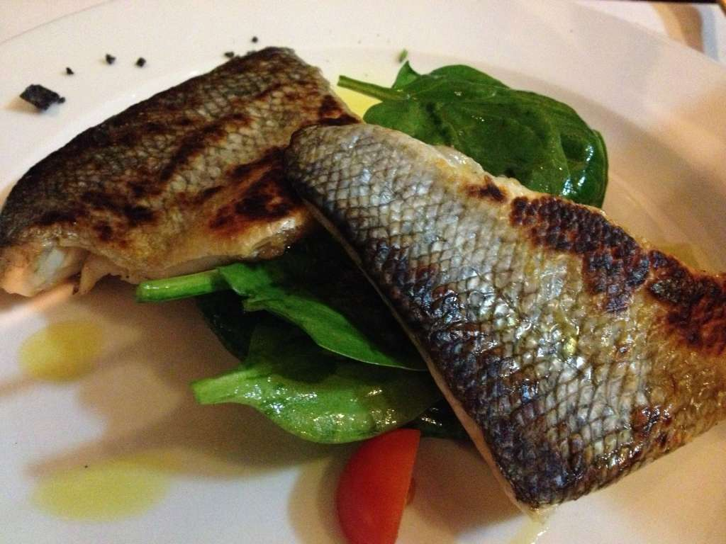 Bronzino with sauteed spinach.