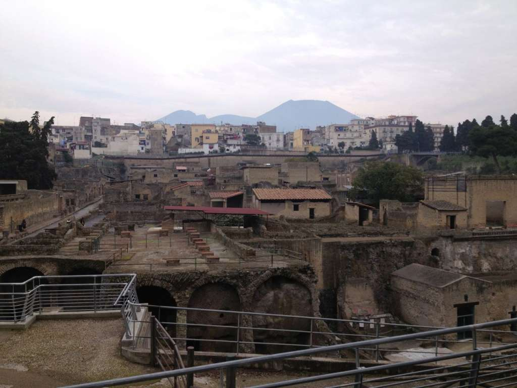 Layers of history: the archeological site of Herculaneum with Ercolano and Vesuvius in the background.