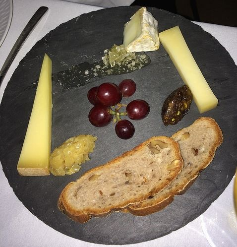 Cheese plate with fennel mostarda, honeycomb and date tapenade.