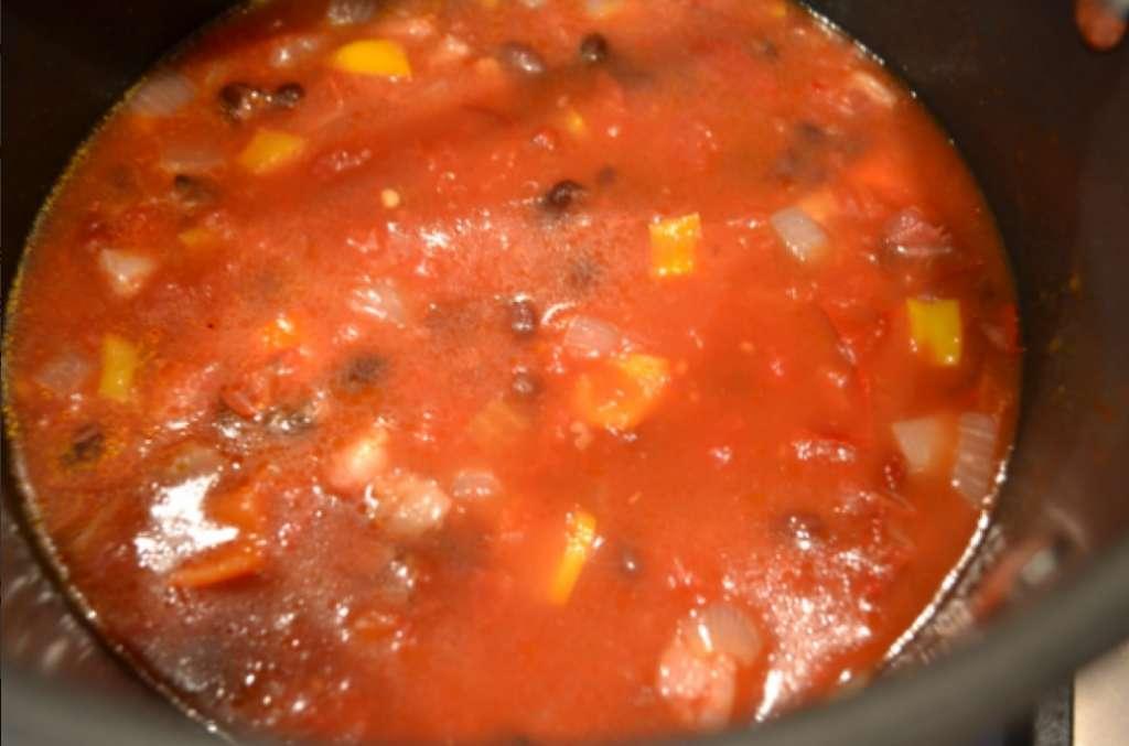 Adding tomatoes, stock.