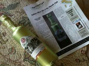 A sample bottle of olive oil and newsletter from Gourmet Cooking & Living.