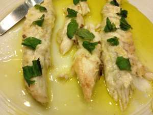 Branzino filets in a simple lemon, herb and olive oil sauce.