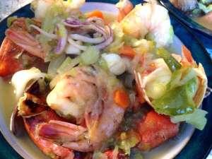 A mixed seafood soup with clams, shrimp and calamari