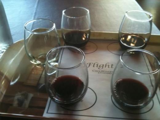 A flight of wines at Cava Winery & Vineyard.