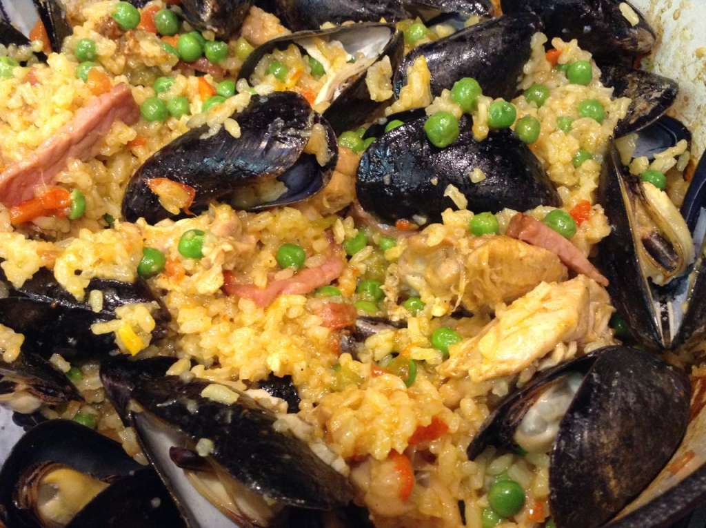 Paella with Mussels, Chicken, Chorizo and Bacon.