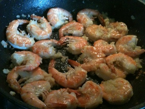 The shrimp have turned pink and are about ready to be removed from the wok.