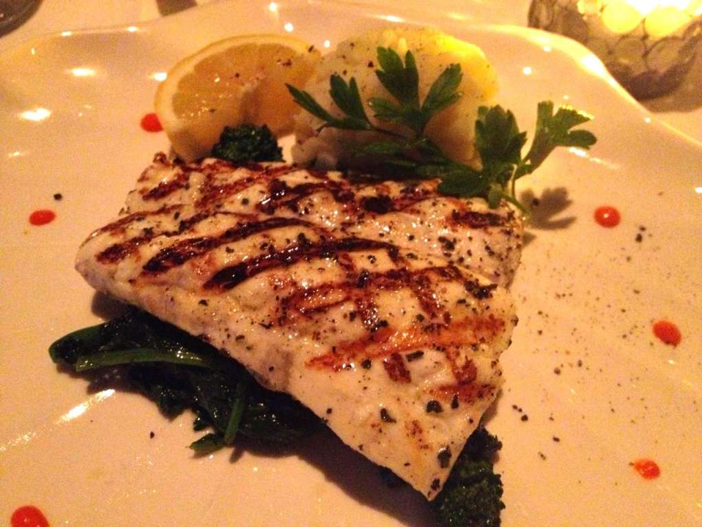 Grilled halibut with broccoli rabe.